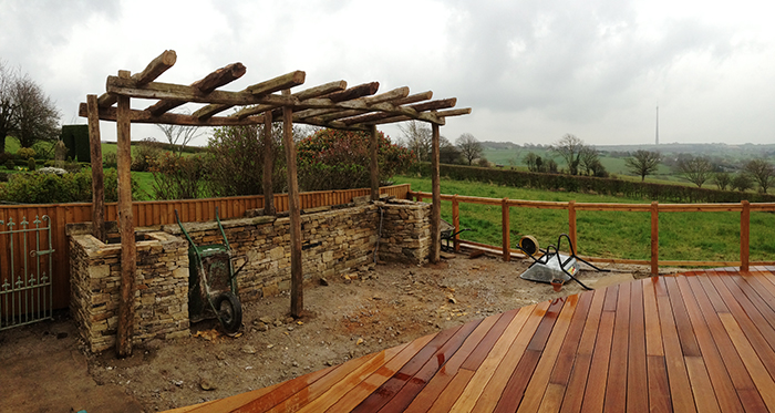 Finished pergola and ground prepared for paving